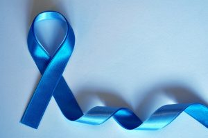 A blue cancer ribbon