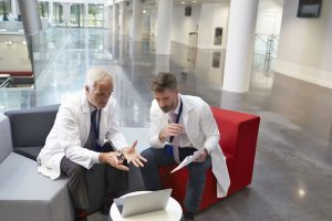 Two doctors looking at a computer screen